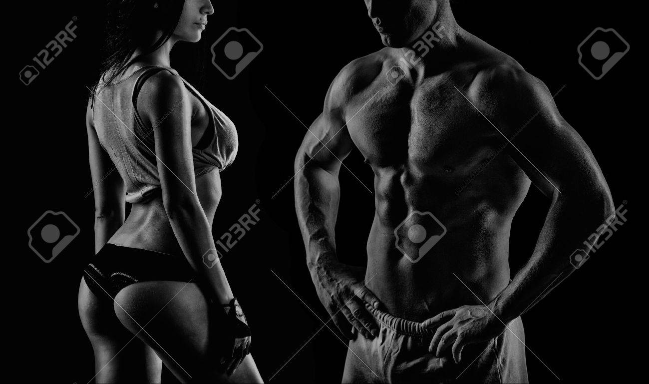 young muscular guy in the studio, posing for the camera with girl Stock Photo - 43856217