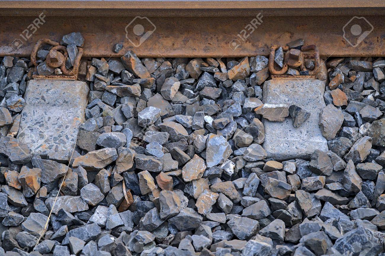 Beautiful closeup view of components of a railway track seen from Blackrock train station, Dublin, Ireland. Sleeper, weld, rail, ballast, fastening - 169047363