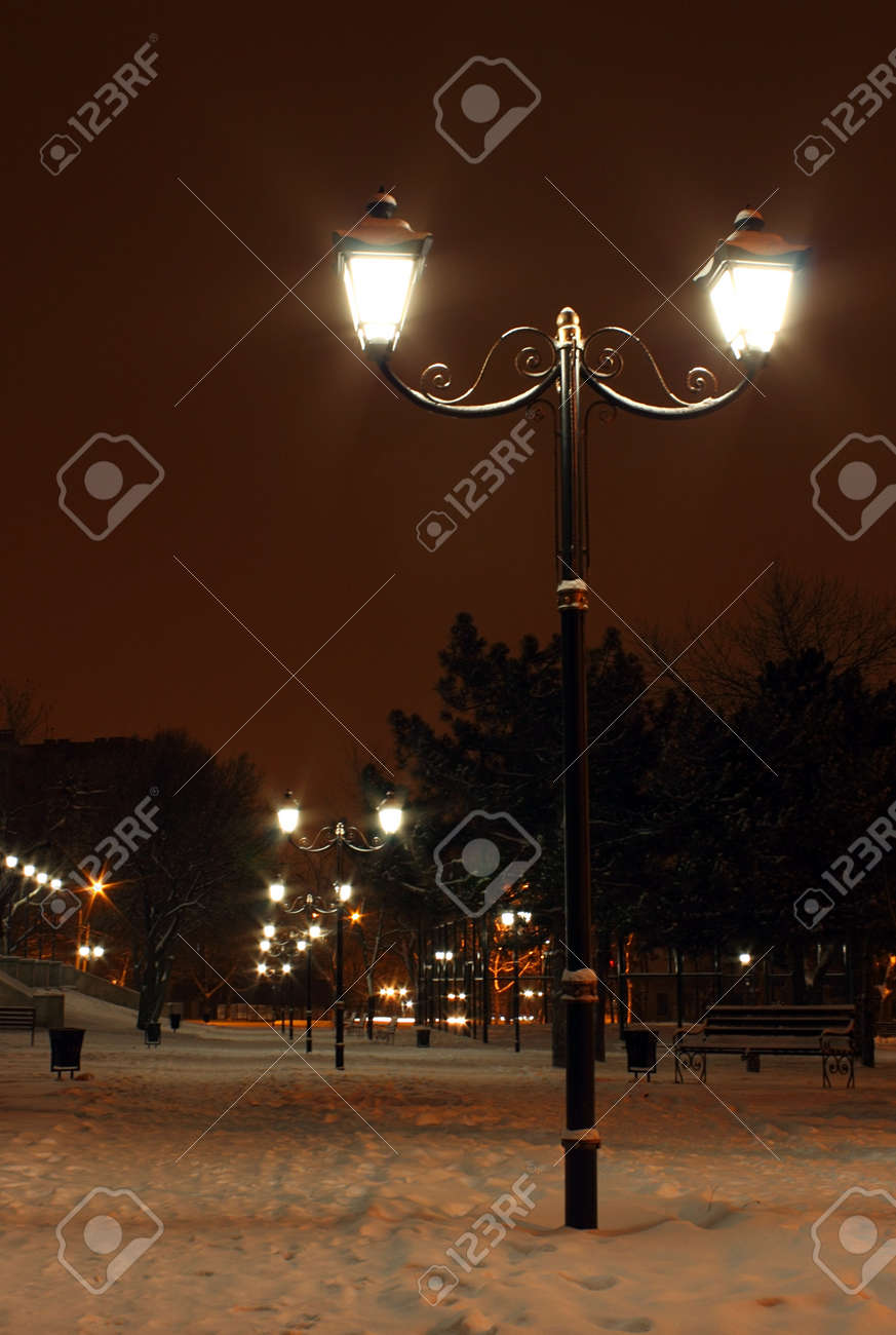 street lantern in park at winter night Stock Photo - 17008988