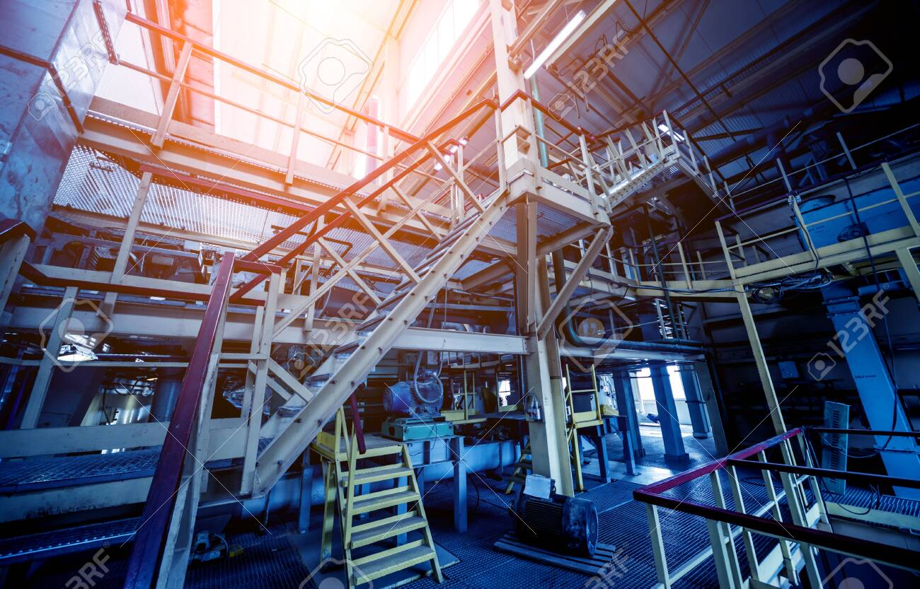 Equipment and pipeline in oil refinery. Industrial background - 145695843
