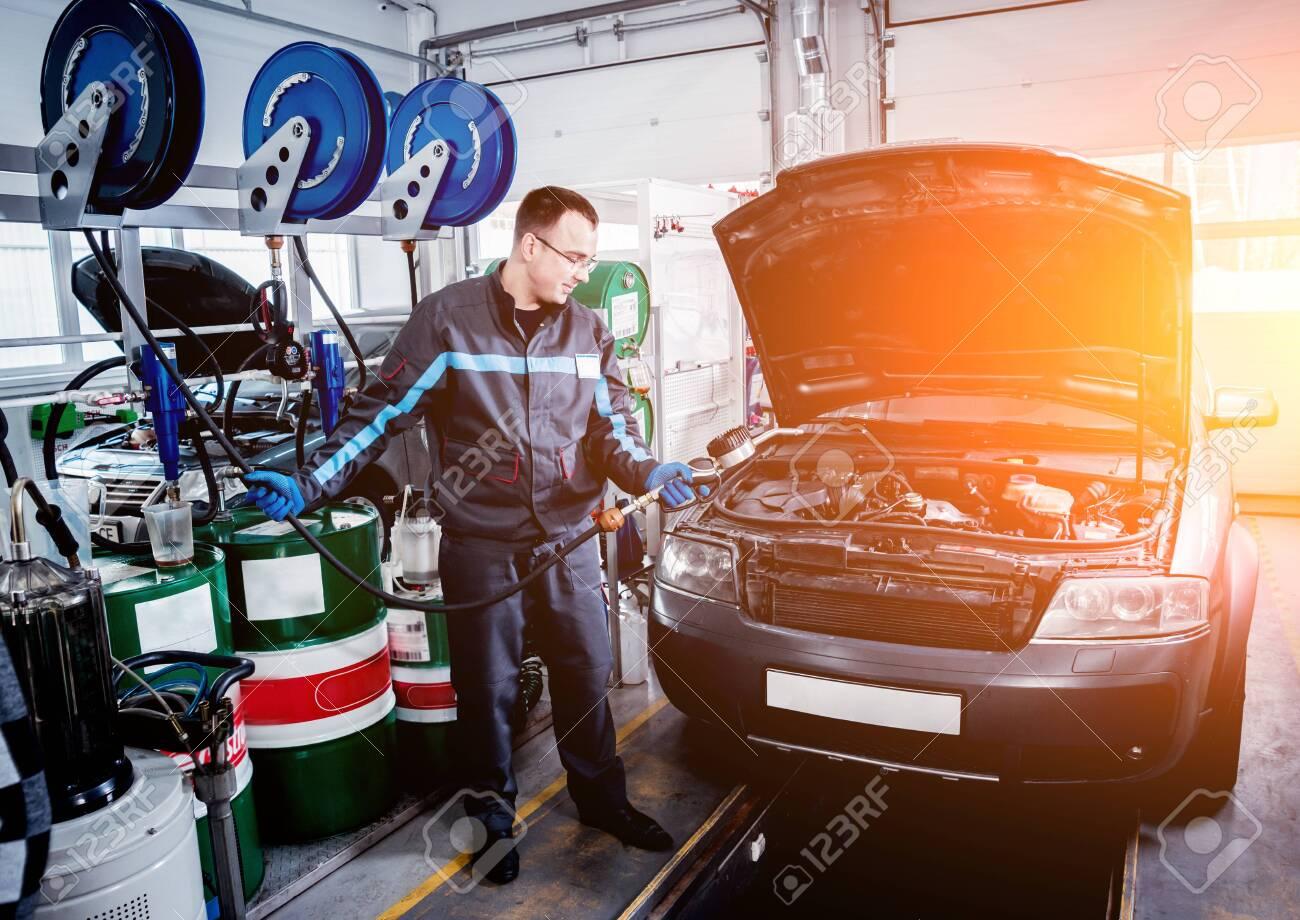 Engine oil change. Car repair. Auto background - 146200590