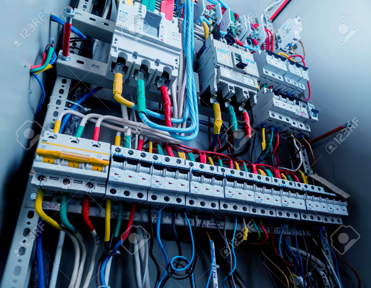 Wires and switches in electric box. Electrical panel with fuses and contactors. Background and texture - 149346200