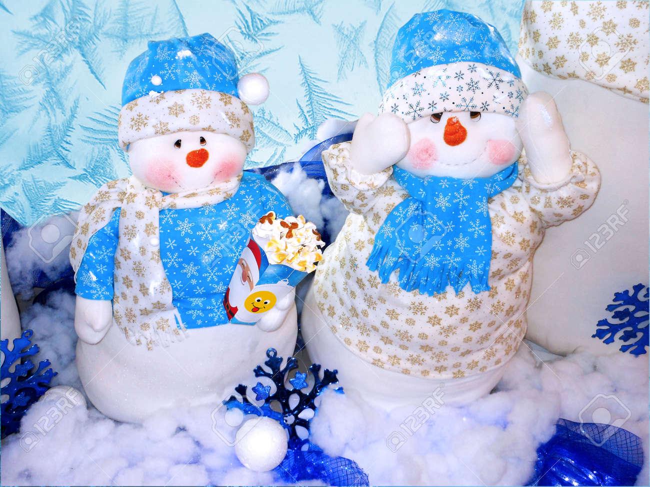 Snowmen At Christmas.Two Snowmen At Christmas