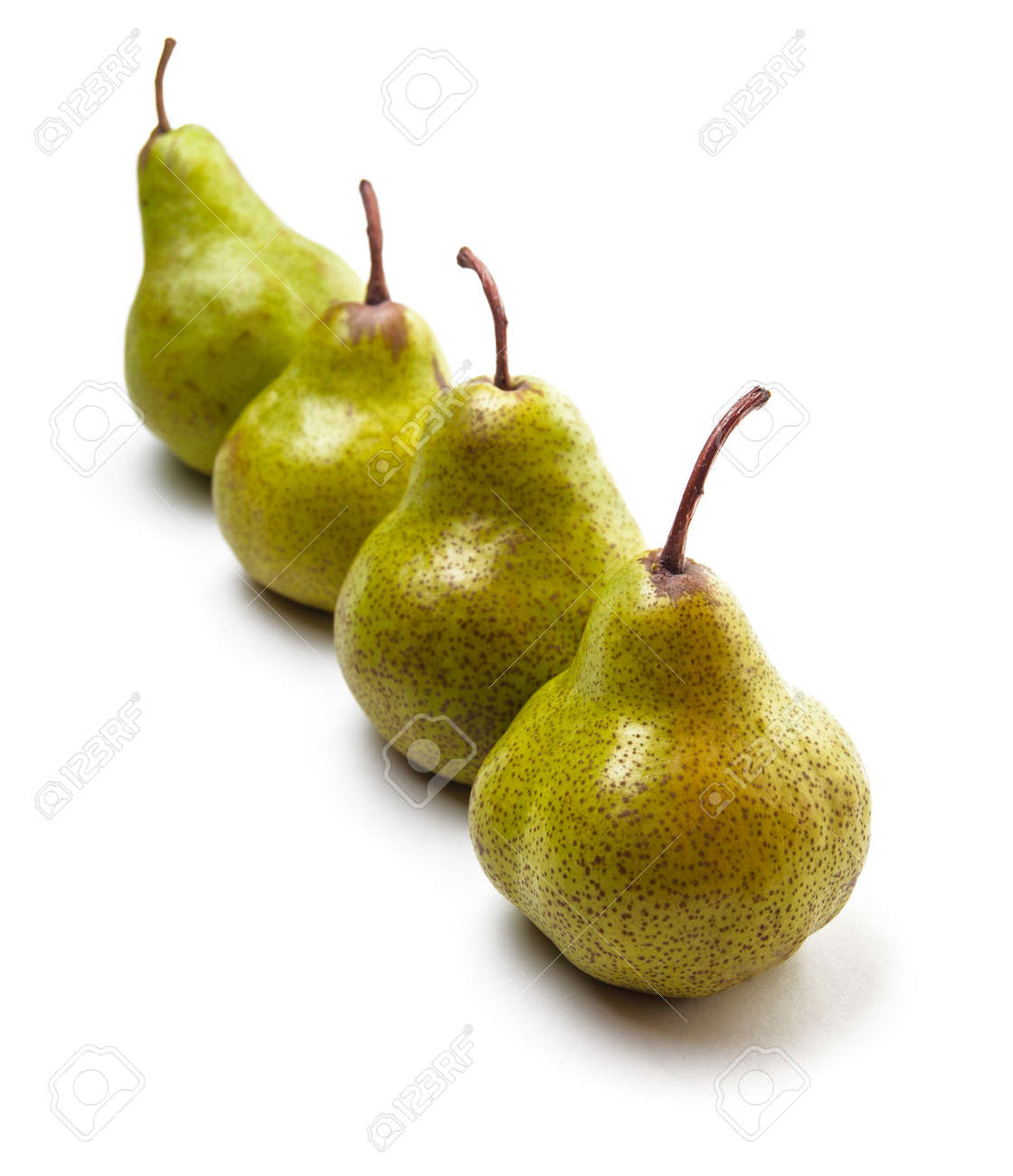 Four pears in a row isolated on white Stock Photo - 19596906
