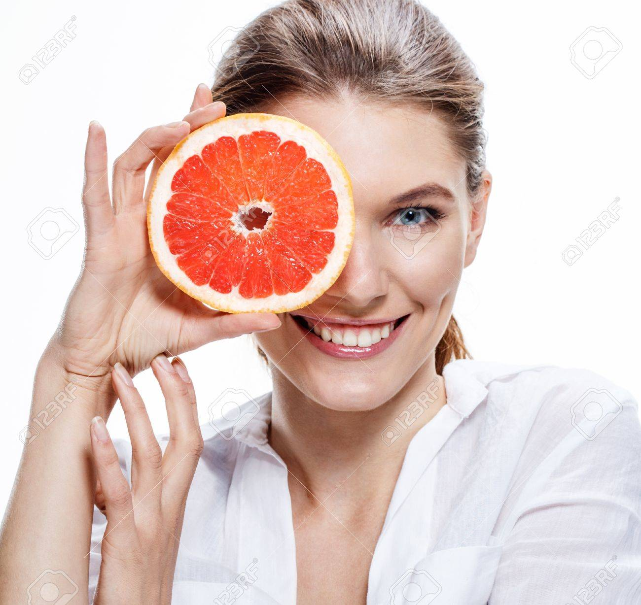 smiling brunette european woman with mottled orange slice - isolated on white background Stock Photo - 21217254
