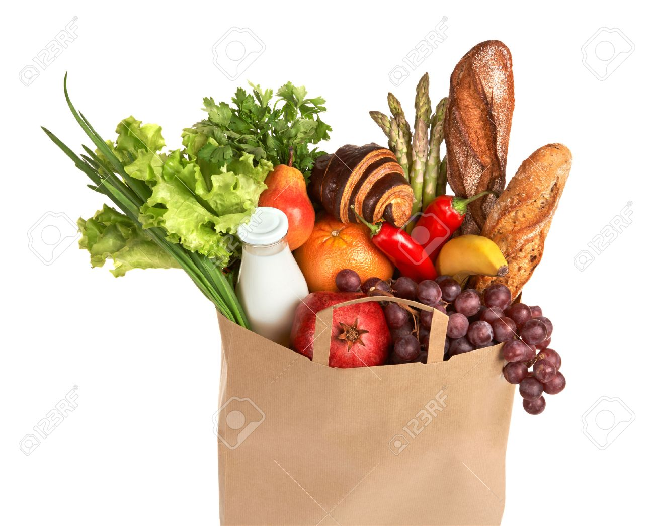 a grocery bag full of healthy fruits and vegetables studio stock