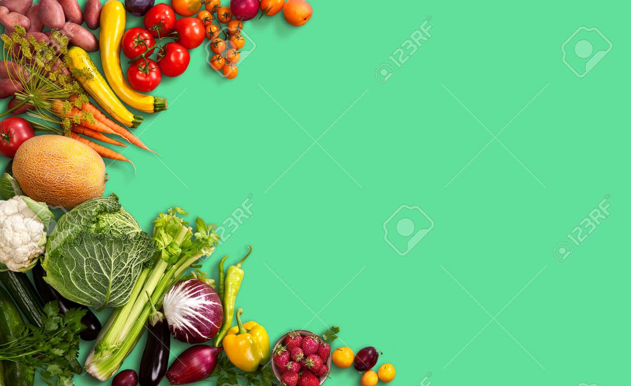 Food background studio photo of different fruits and vegetables - Super Food Background Studio Photo Of Different Fruits And Vegetables On Green Backdrop Stock