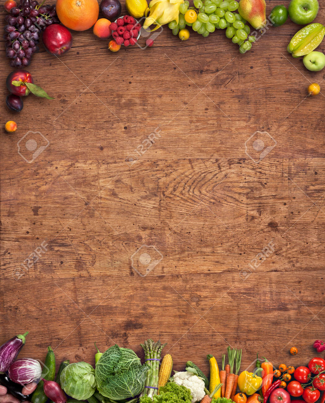Food background studio photo of different fruits and vegetables - Healthy Food Background Studio Photography Of Different Fruits And Vegetables On Old Wooden Table Stock