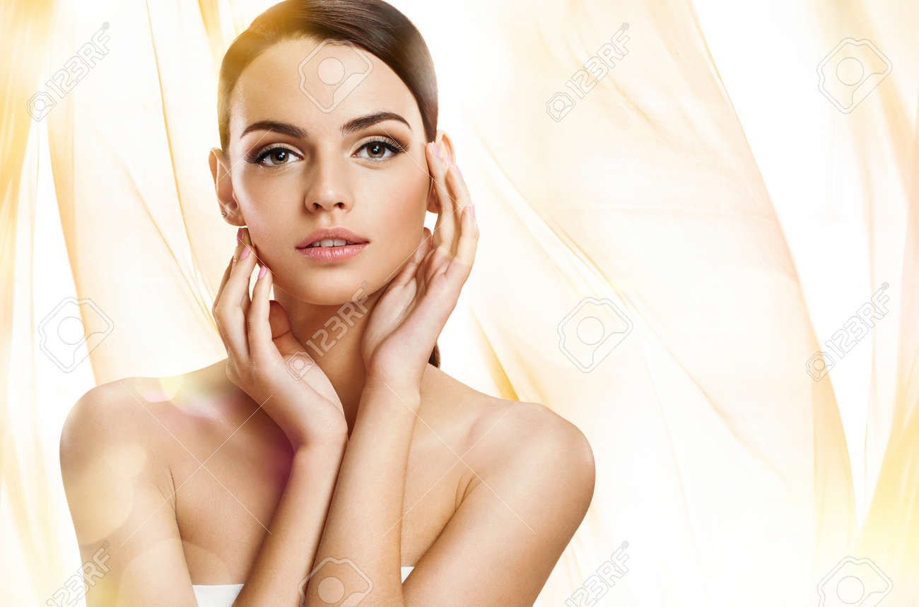 photoset of attractive brunette girl on wavy orange background Stock Photo - 38215036