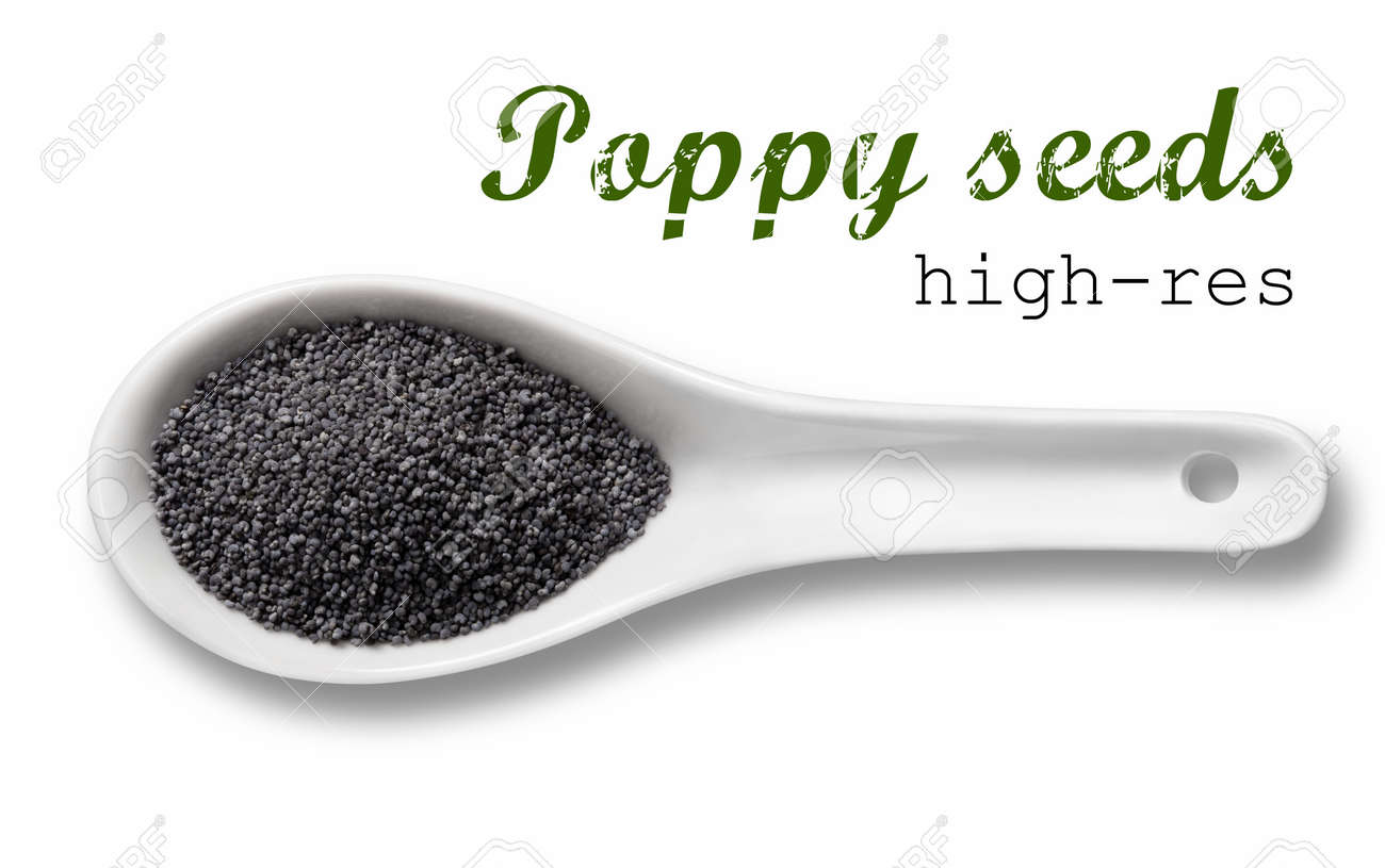 Poppy seeds in a wooden spoon / high resolution product photography