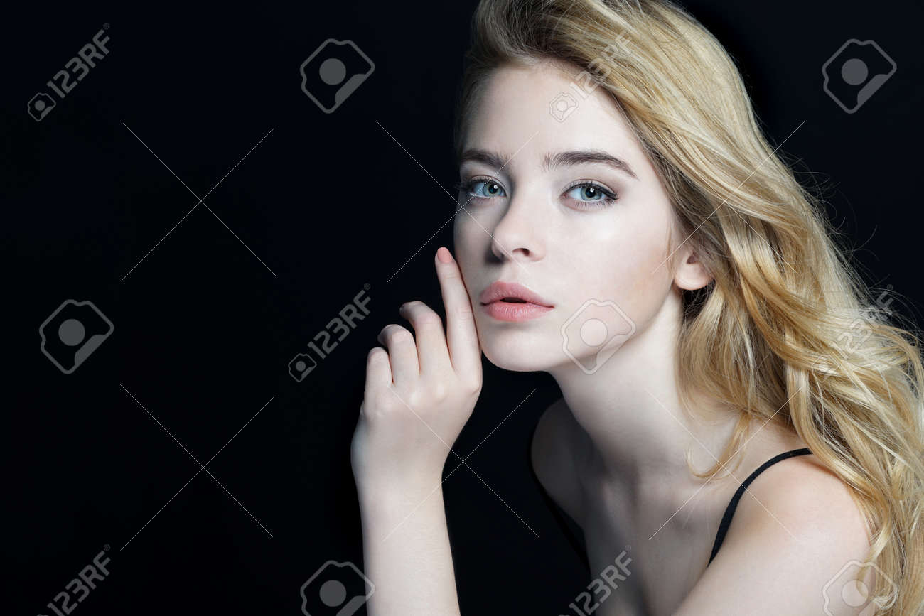 Beautiful Girl face. Perfect skin. Close-up of an attractive girl of European appearance on dark background. - 52582771