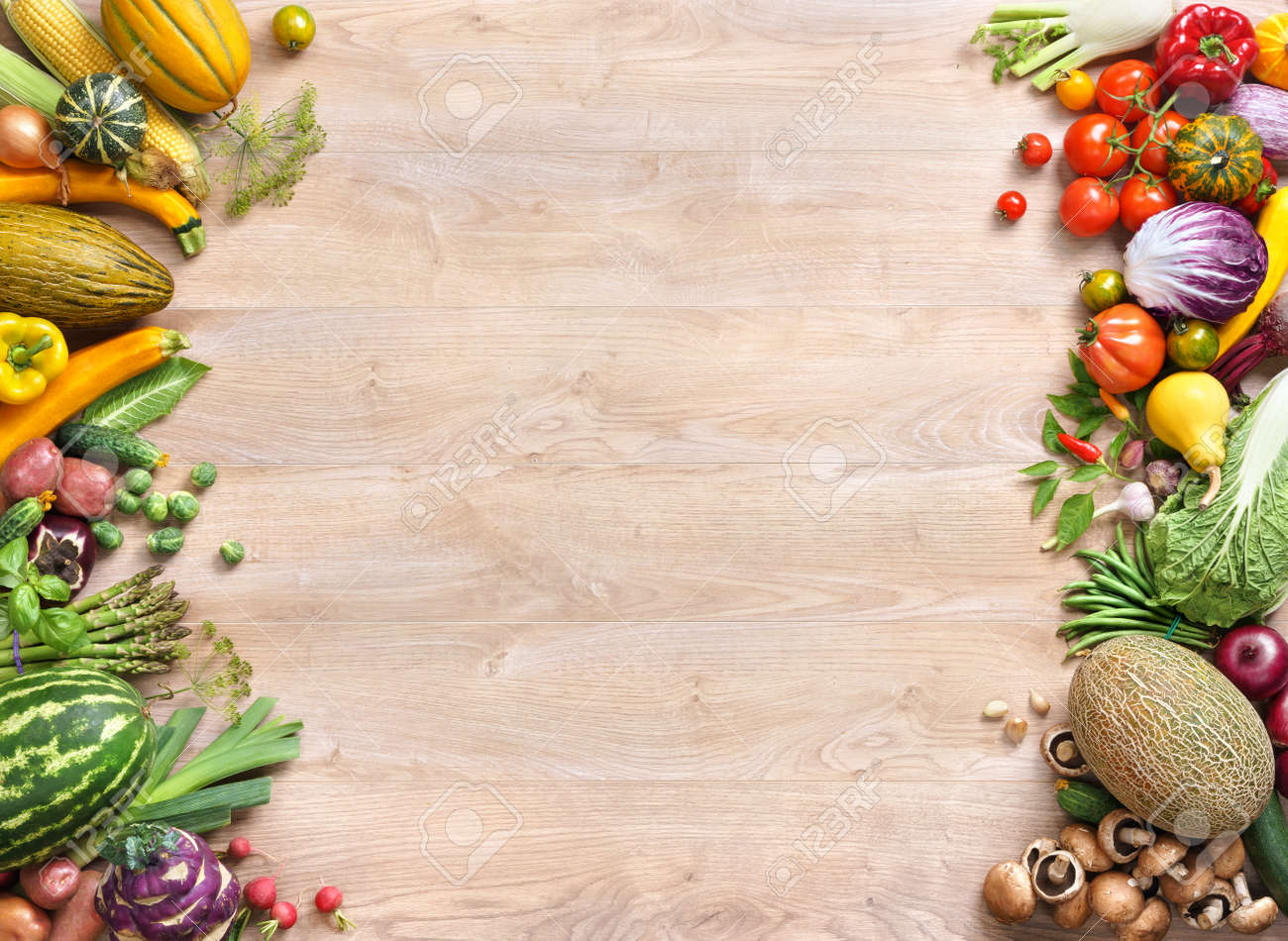 Food background studio photo of different fruits and vegetables - Healthy Food Background Studio Photo Of Different Fruits And Vegetables On Old Wooden Table Stock