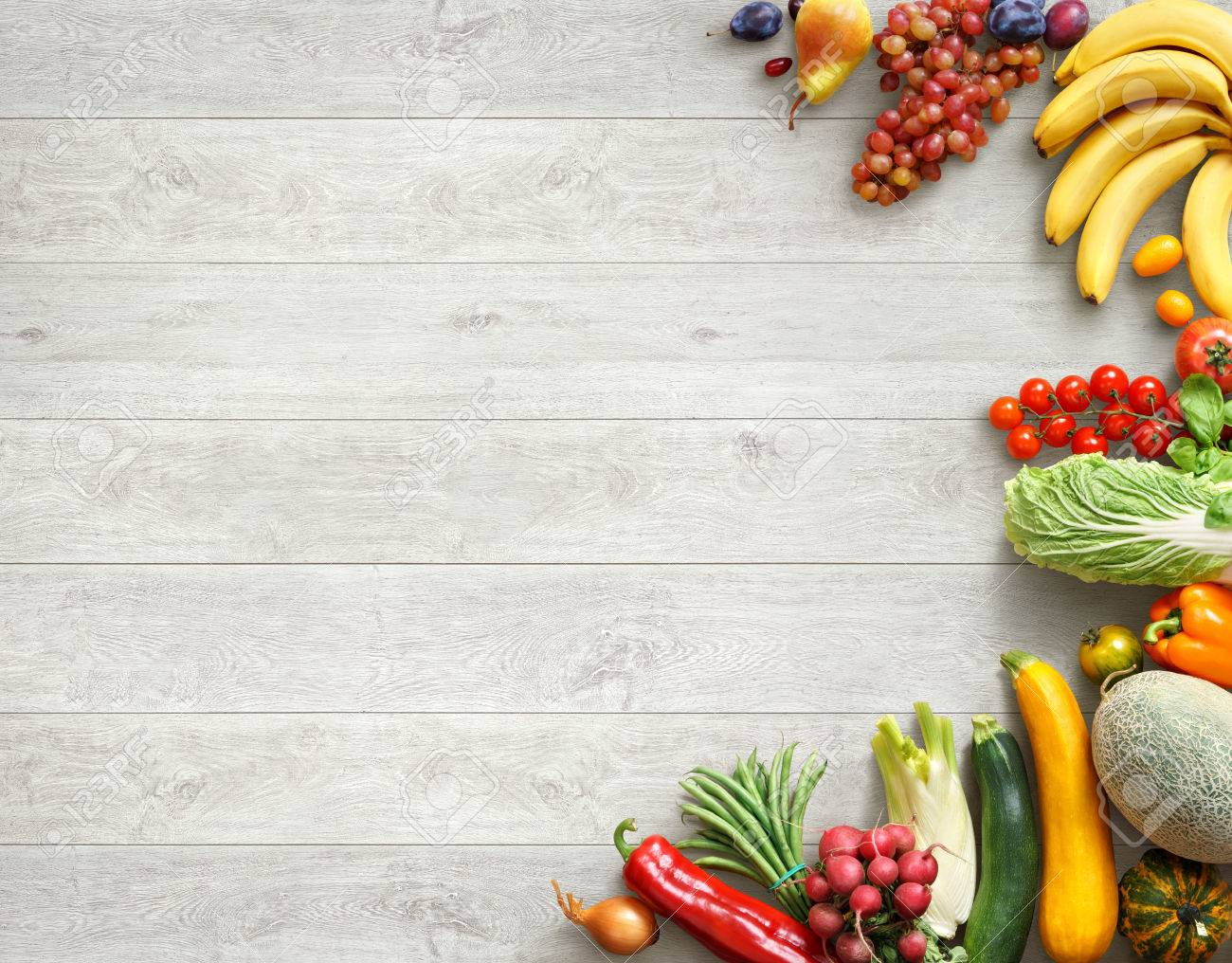Food background studio photo of different fruits and vegetables - Healthy Food Background Studio Photo Of Different Fruits And Vegetables On White Wooden Table