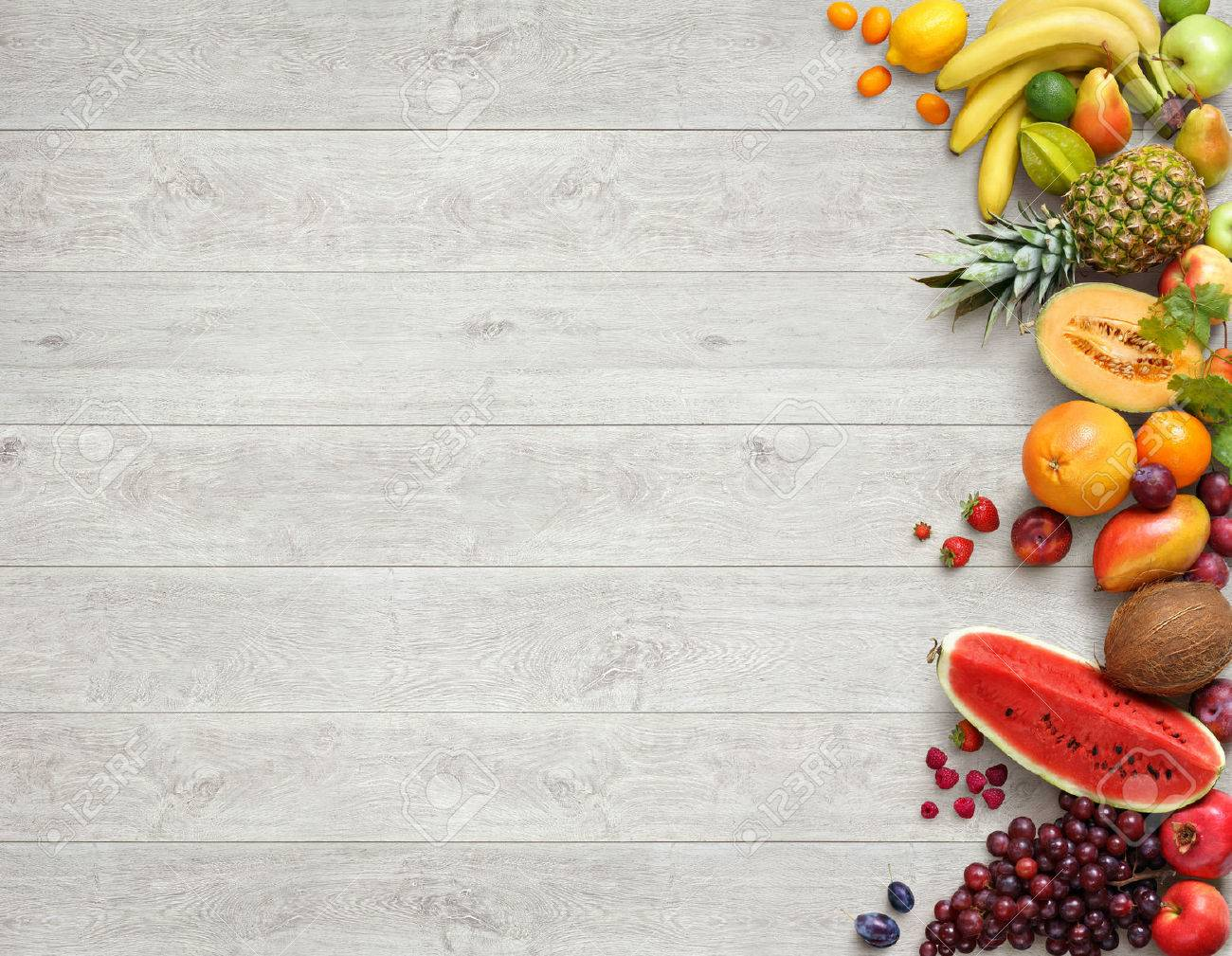 Healthy food background. Studio photo of different fruits on white wooden table. High resolution product. - 54088765