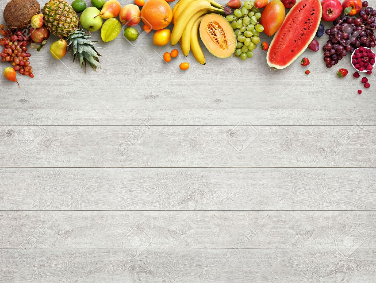 healthy food background studio photo of different fruits on stock