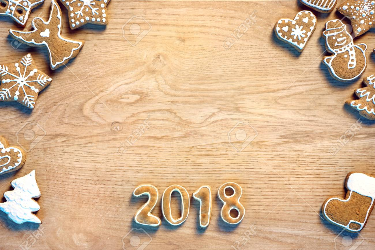 high resolution product merry christmas and happy new year christmas cookies on wooden background copy space for