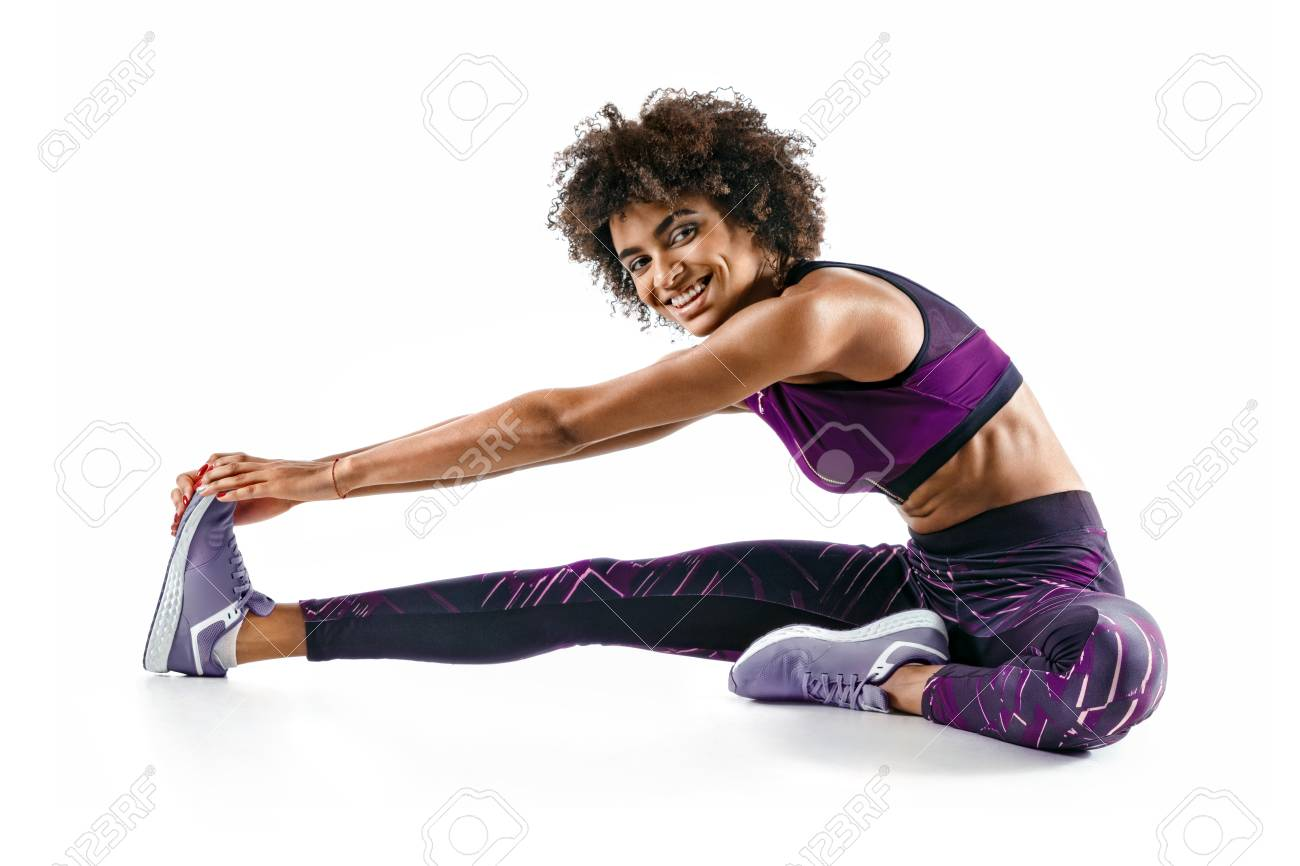 Sporty Girl Stretching Her Hamstrings. Photo Of Smiling African ...