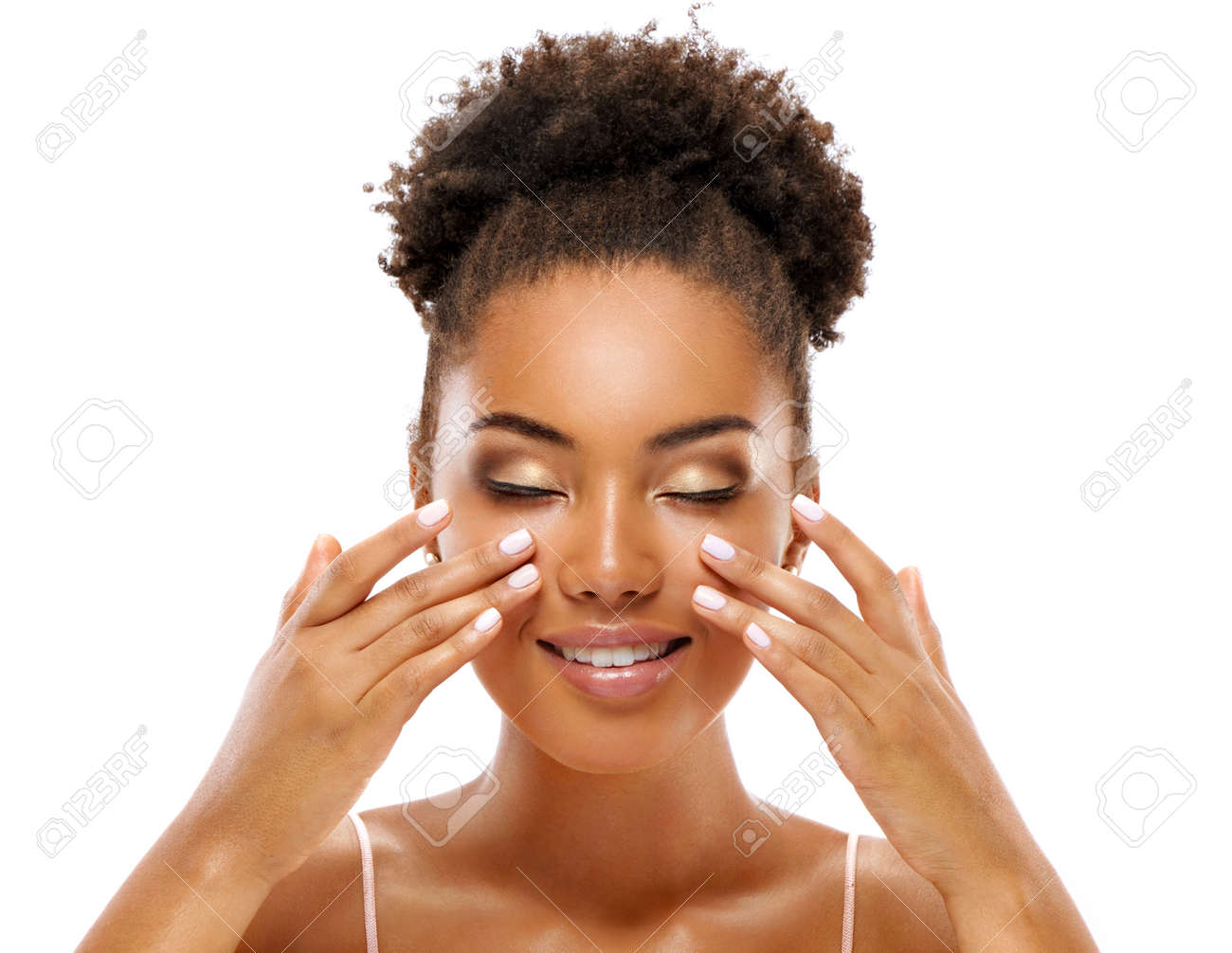 Beautiful woman doing facial massage, touching her face. Photo of african woman with clean healthy skin on white background. Skin care and beauty concept - 112682270