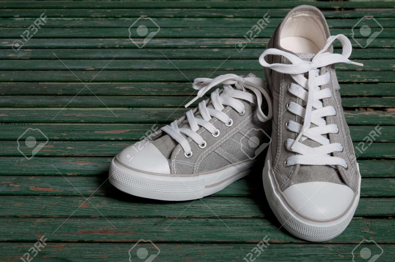 Gray On Wooden Sneakers A Background nOPwN8kX0Z