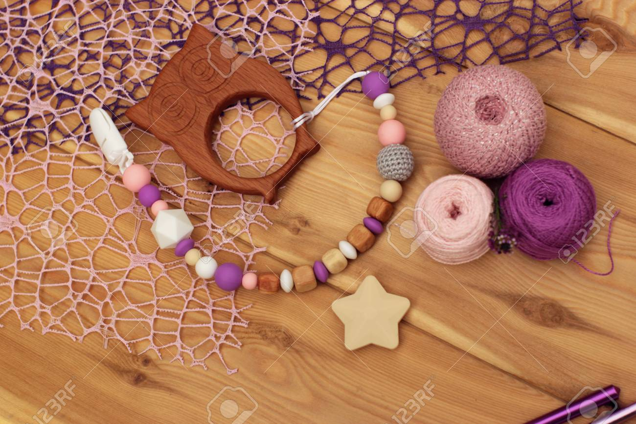 Flat Lay Crocheted Baby Pacifier Holder Yarn Balls And Crochet