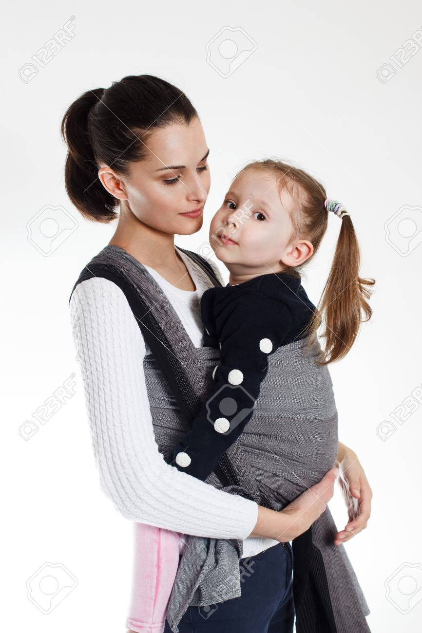 A toddler girl in front cross carry wrap in woven baby carrier - 120893616