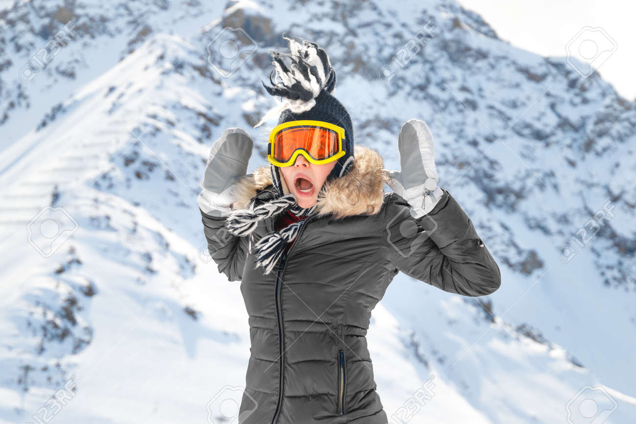 Surprise in the mountains travel. Lifestyle portrait of a cheerful caucasian woman with long curly hair. Traveling in the mountains. - 157624818