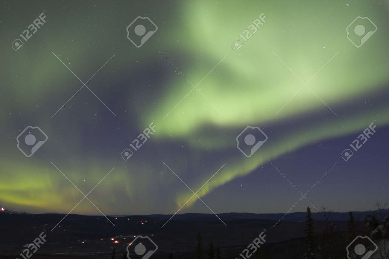 Northern lights in the winter sky Stock Photo - 635718