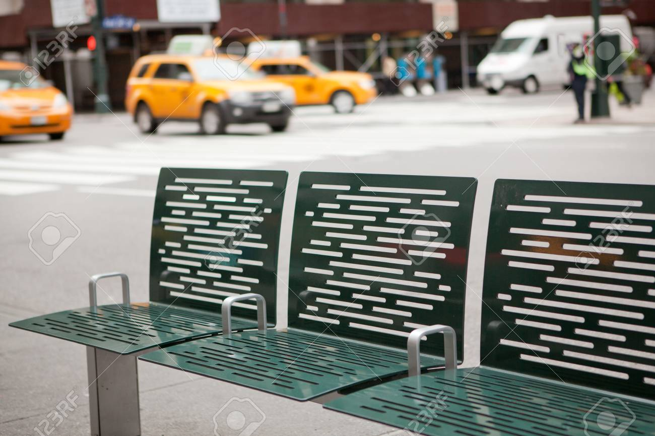 Street of New York with bench and taxis in background Stock Photo - 16189687