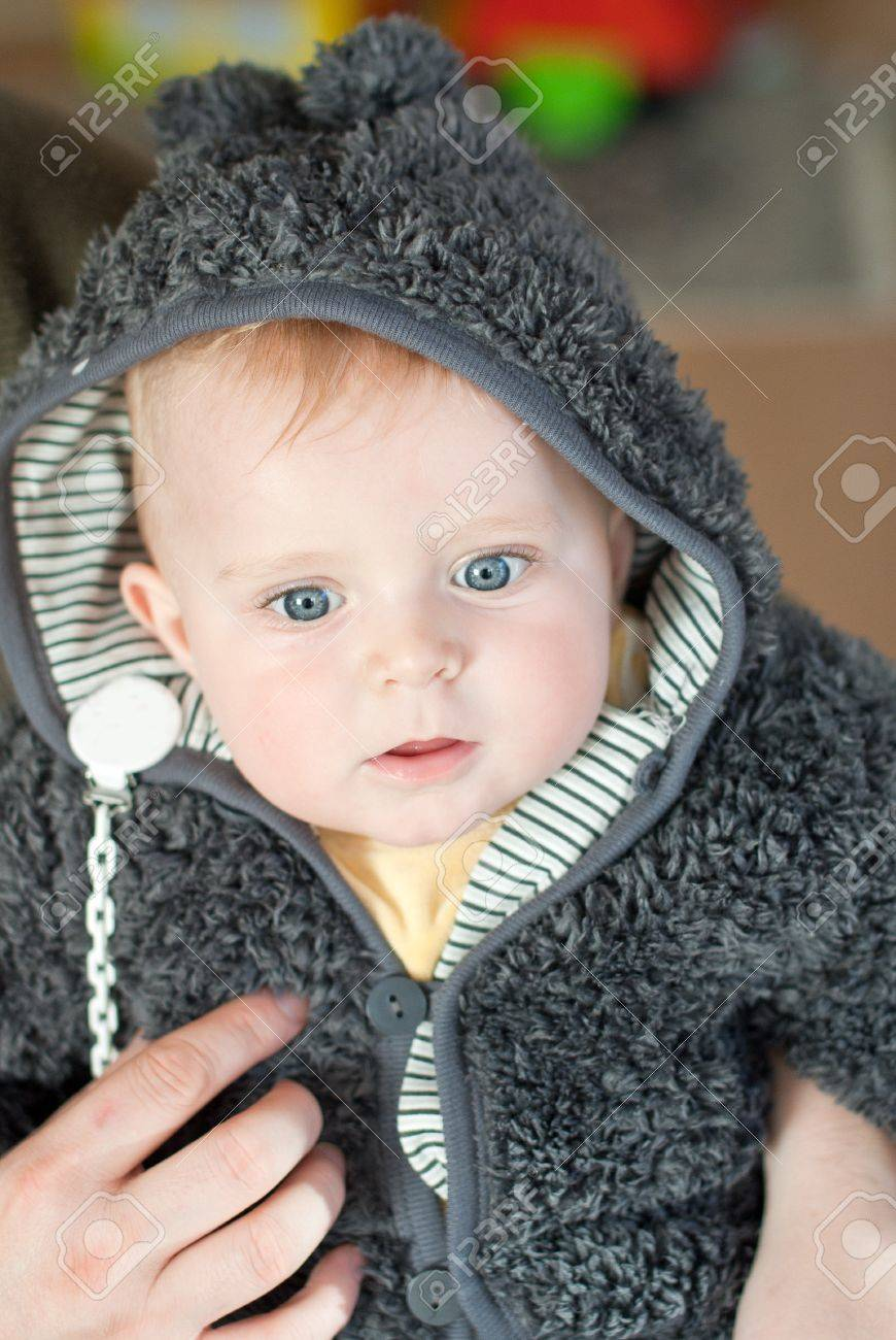 sweet baby boy in warm winter clothes stock photo, picture and