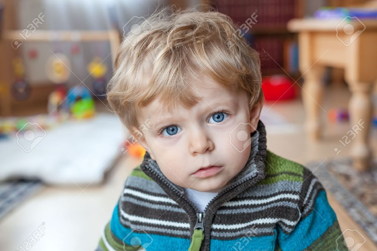 Adorable toddler with blue eyes and blond hair indoor Stock Photo - 16732318