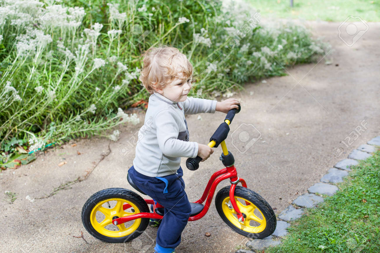 e3e8cabccac 2 years old toddler child learning to ride on his first bike Stock Photo -  17034715