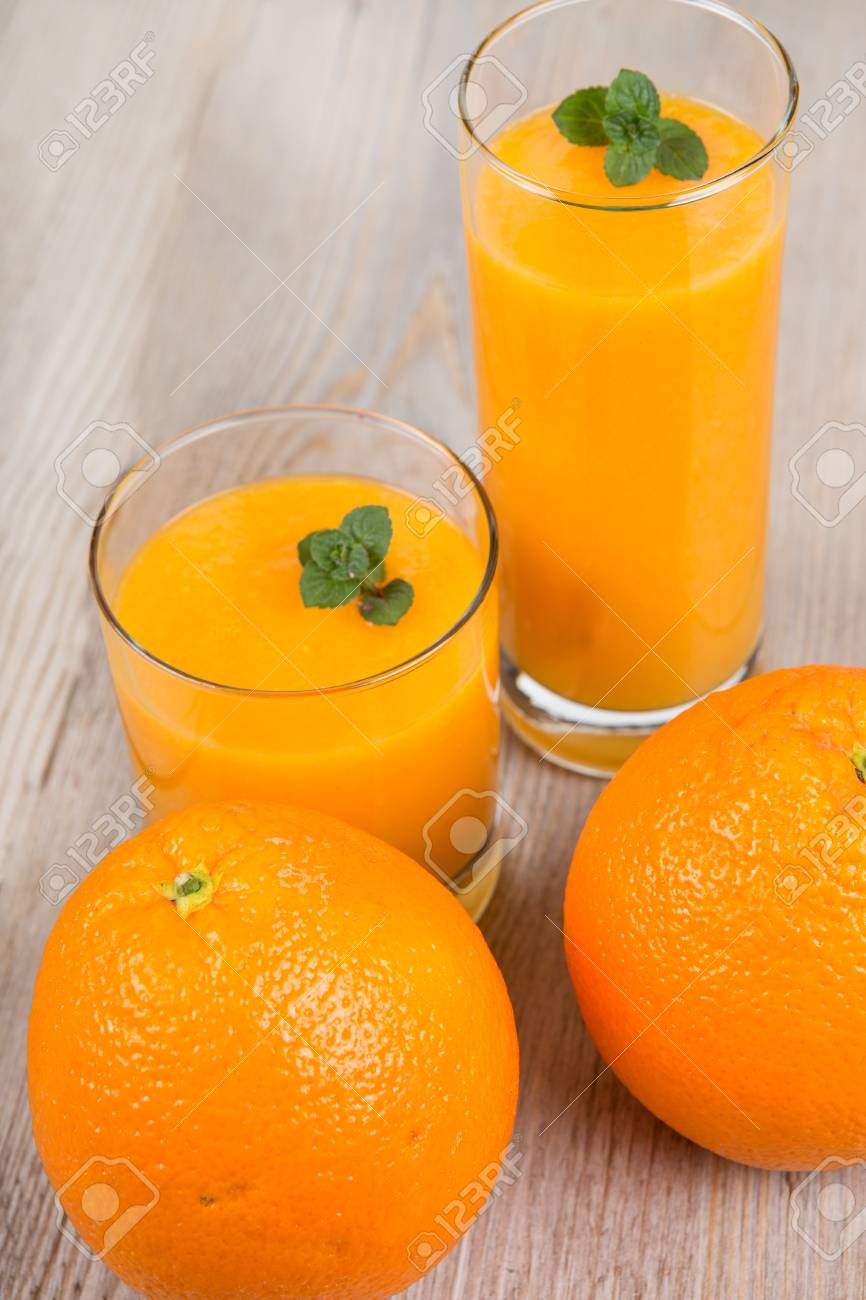 Fresh orange and ginger smoothie drink  On wooden background Stock Photo - 17732087