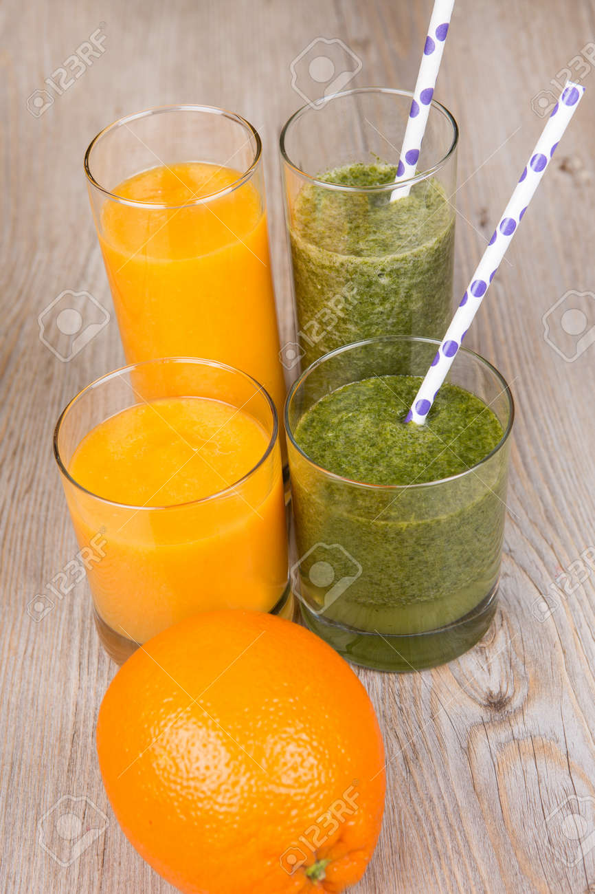 Fresh orange and spinach smoothie drink  On wooden background Stock Photo - 17732098