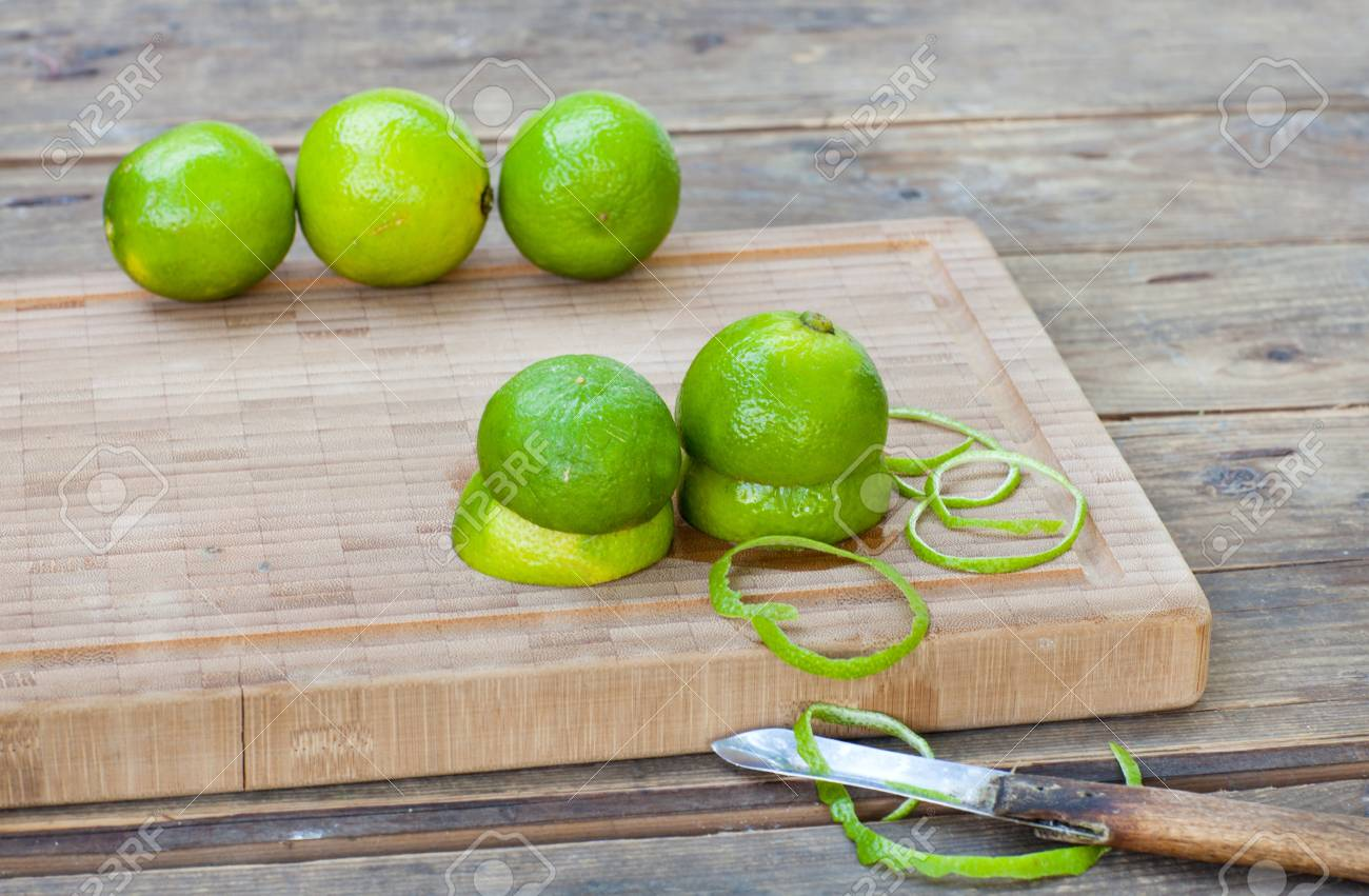 Fresh green ripe limes on old wooden table Stock Photo - 21639402