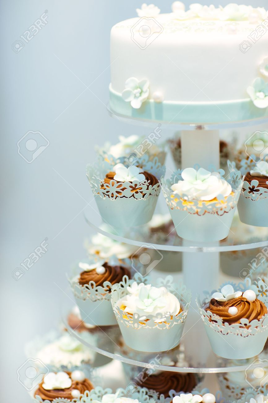 Wedding Cake And Cupcakes In Brown And Cream In Blue, White And ...