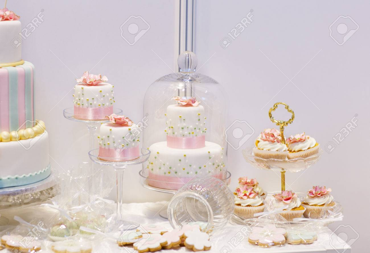 Elegant Sweet Table With Big Cake, Cupcakes, Cake Pops On Dinner ...