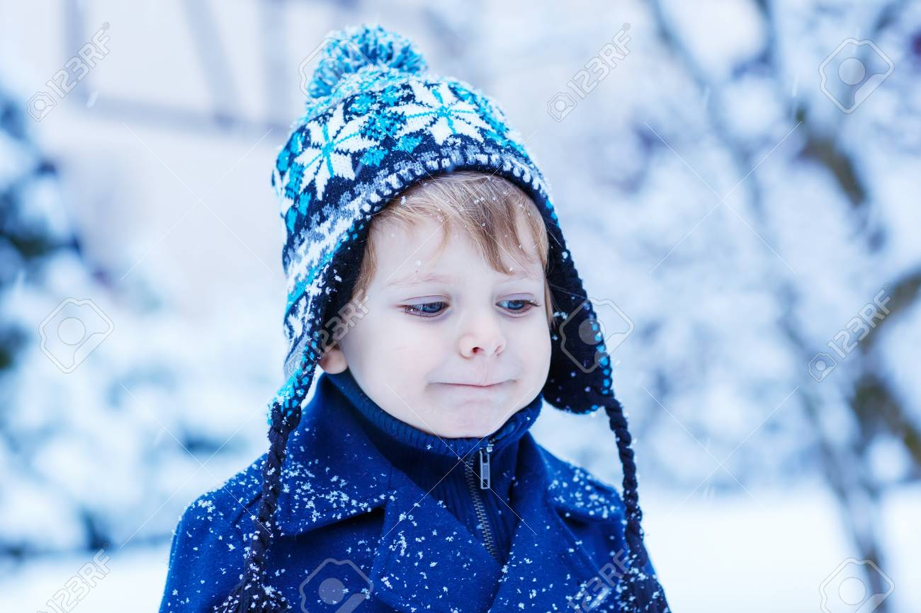 8749e4bcb Cute Little Child In Winter Clothes With Falling Snow. Kid Enjoying ...