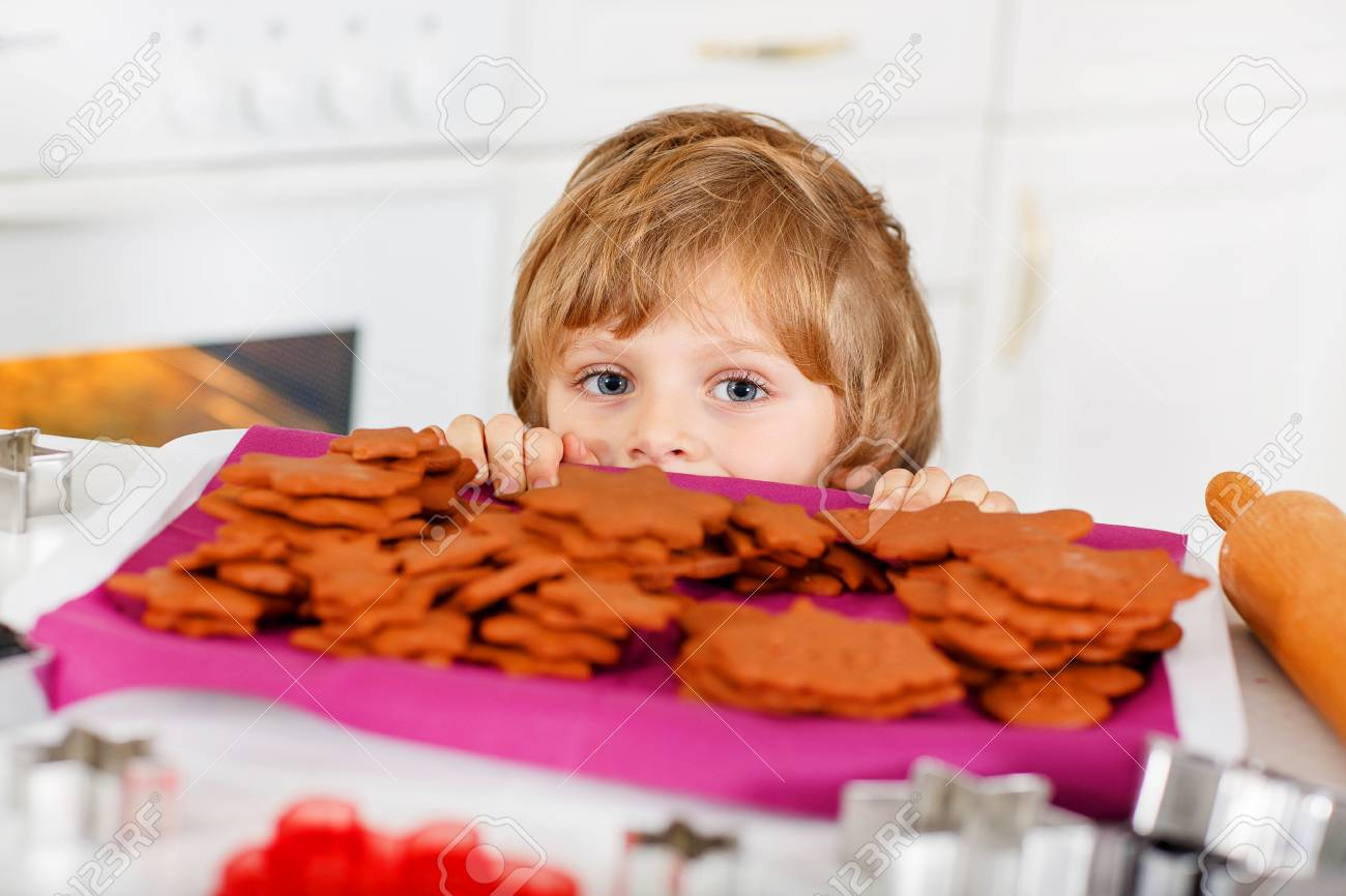 Funny Kid Boy Baking Christmas Cookies At Home. Adorable Blond ...