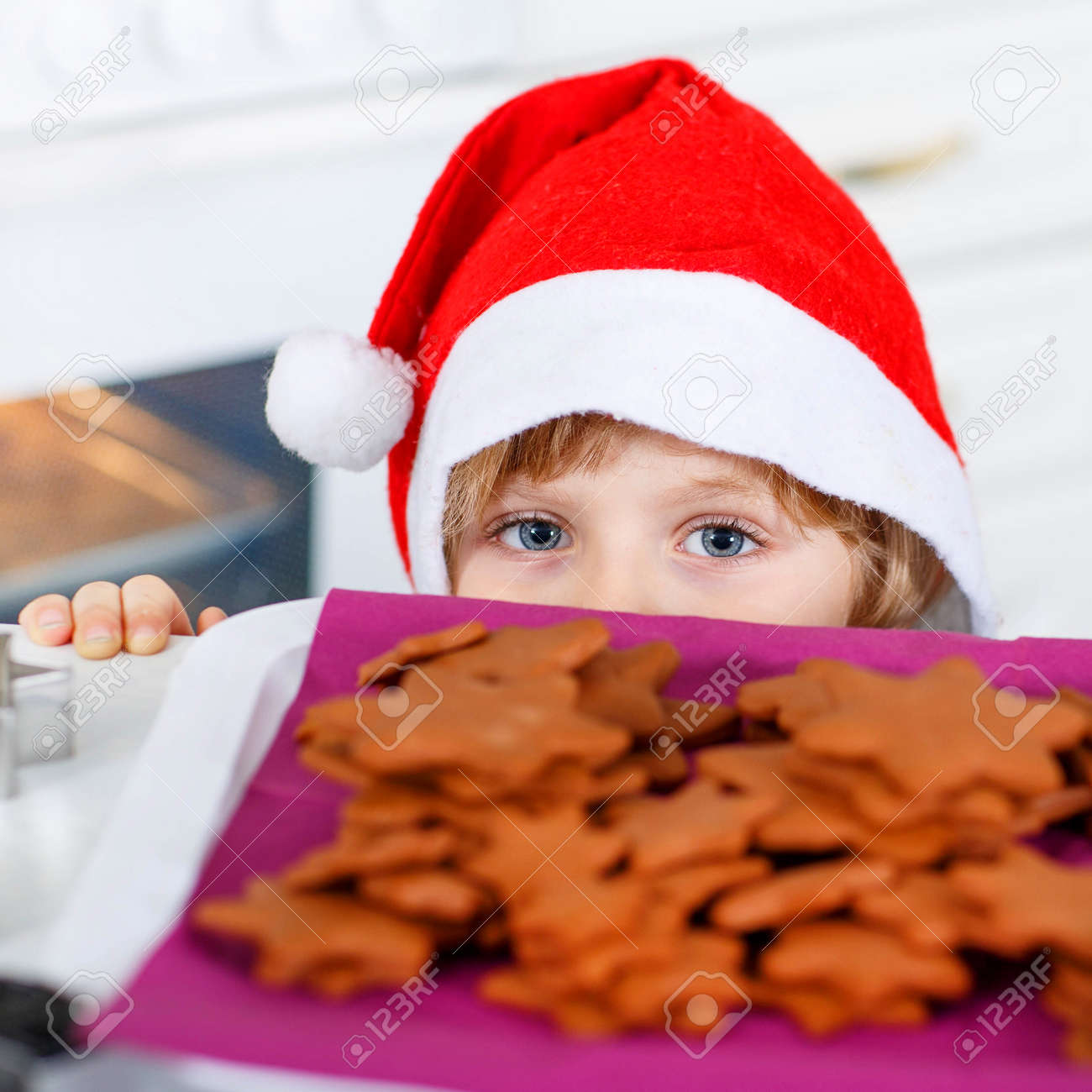 Funny Kid Boy In Santa Claus Hat Baking Christmas Cookies At.. Stock ...