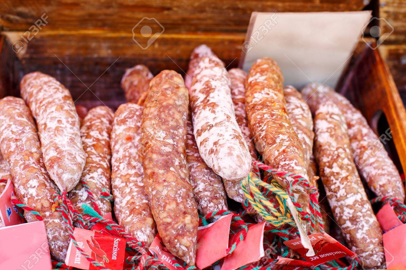 French saucissons and ham display in market in south of France, Arles, Provence. Local organic food. - 50518049