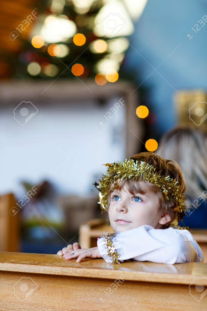 Beautiful Little Kid Boy Playing An Angel In Christmas Story.. Stock ...