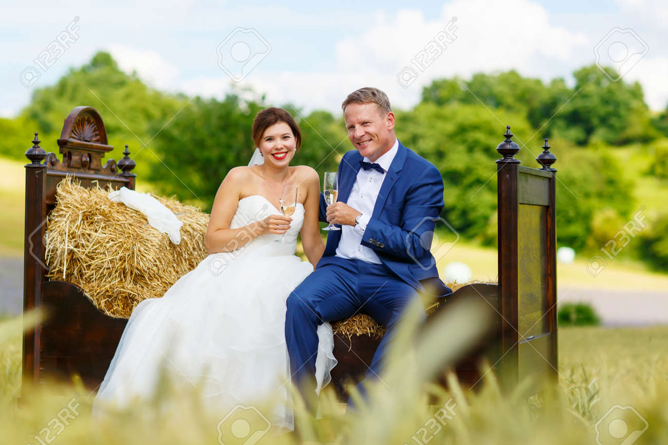 Happy Wedding Couple On Harvest Field Beautiful Bride Young