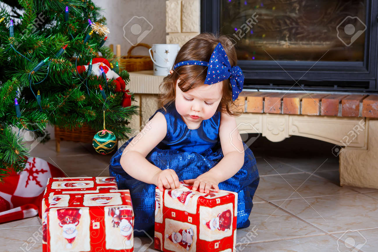 Adorable Kid Girl Playing With Christmas Tree Decoration. Toddler ...