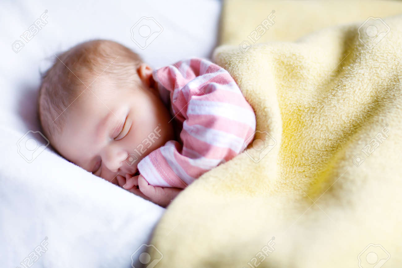 Portrait of cute adorable newborn baby girl sleeping stock photo 69832373