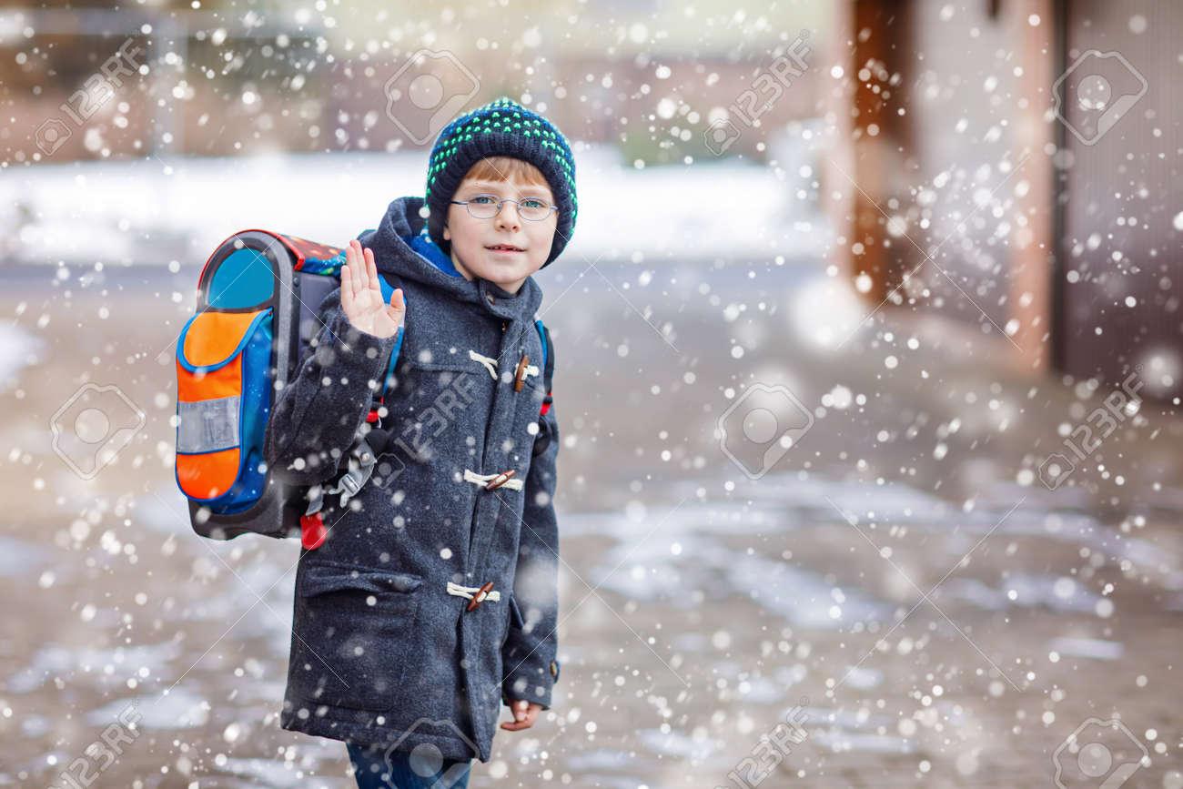 Little school kid boy of elementary class walking to school. - 71839776