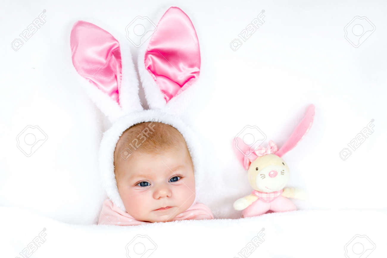 6aeb37e4f Adorable cute newborn baby girl in Easter bunny costume and ears. Stock  Photo - 74037325