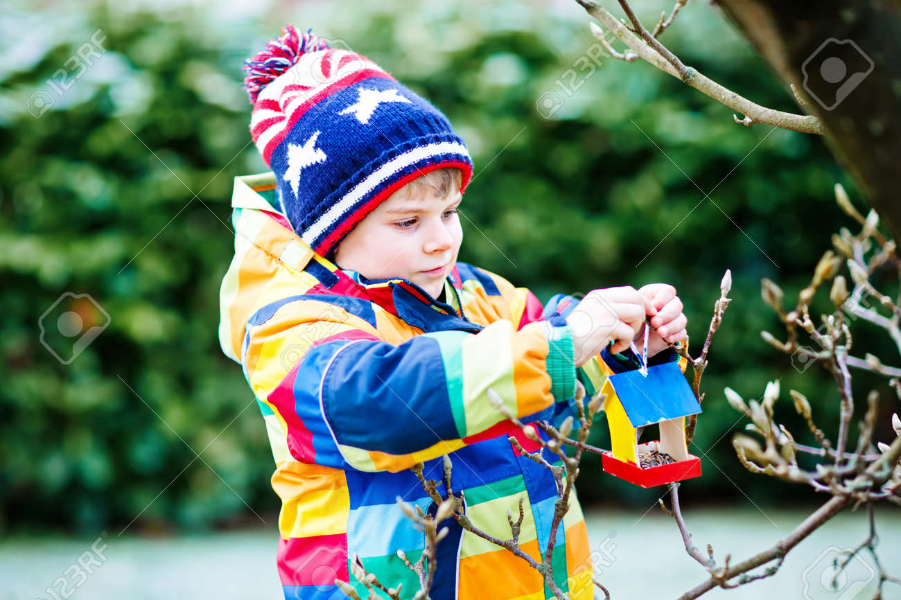 Enjoyable Little Kid Boy Hanging Bird House On Tree For Feeding In Winter Download Free Architecture Designs Scobabritishbridgeorg