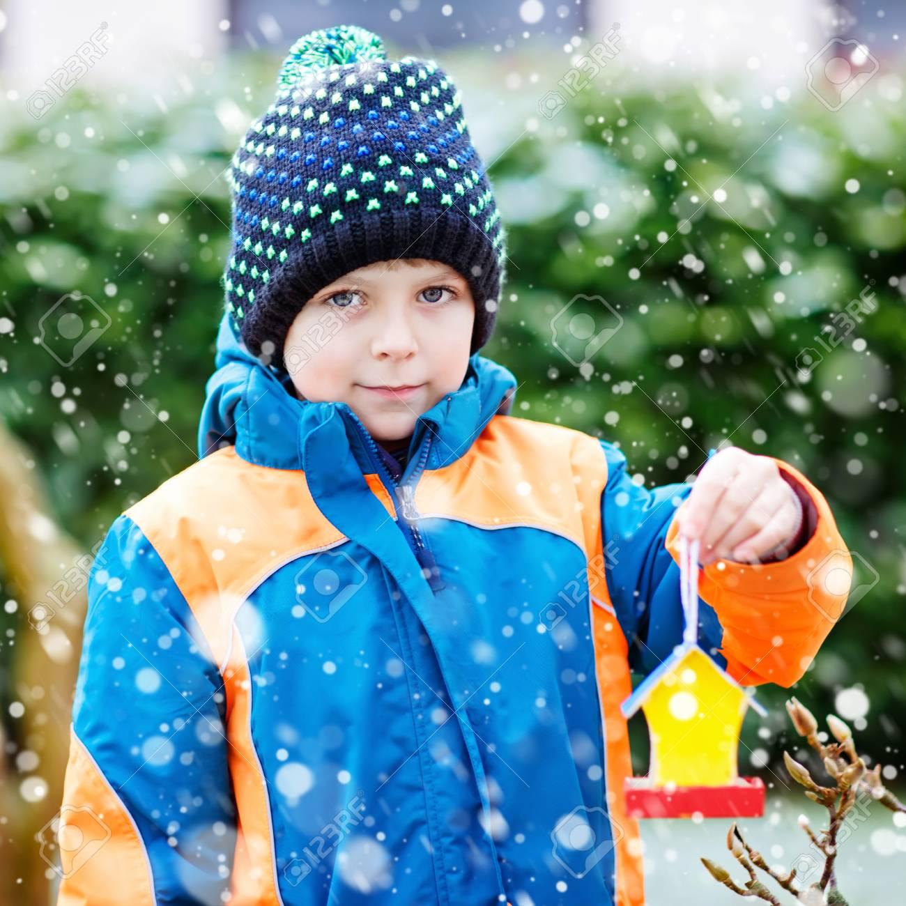 Stupendous Little Kid Boy Hanging Bird House On Tree For Feeding In Winter Download Free Architecture Designs Scobabritishbridgeorg