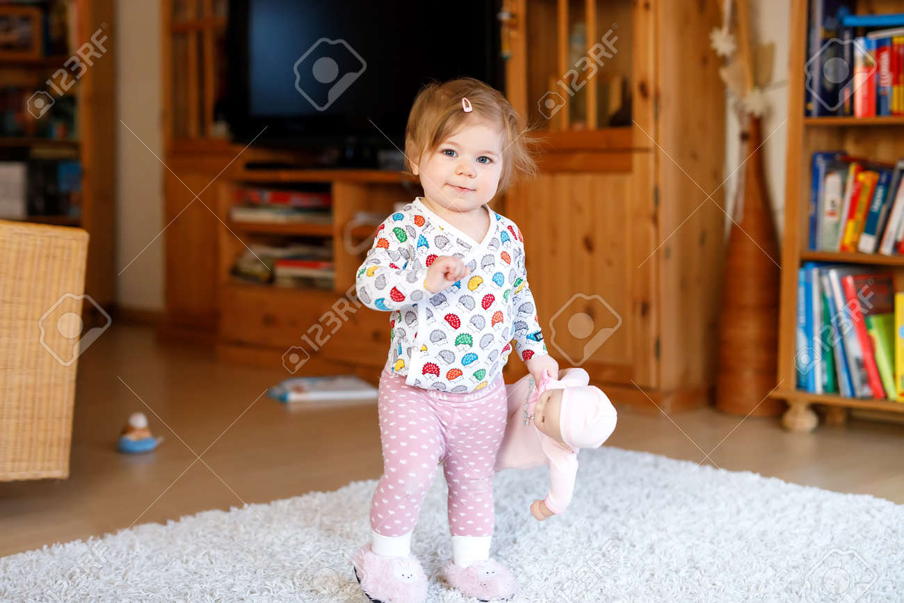 portrait of little cute baby girl learning walking and standing