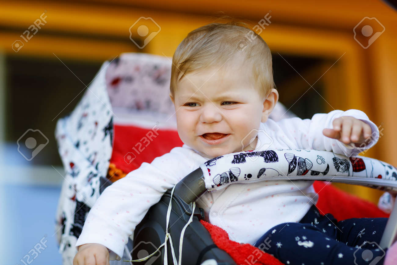 ed24b4df3c21 Cute Little Beautiful Baby Girl Sitting In The Pram Or Stroller ...